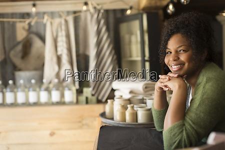 portrait confident female shop owner at