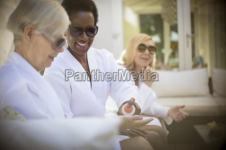 senior women friends in spa bathrobes
