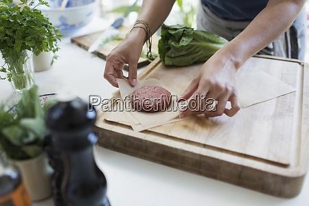 woman making fresh hamburger patties on