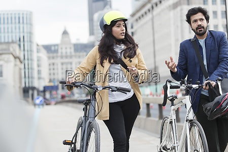 business people with bicycles on city