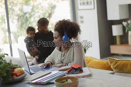 woman working at laptop in dining