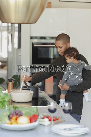 father and baby daughter cooking at