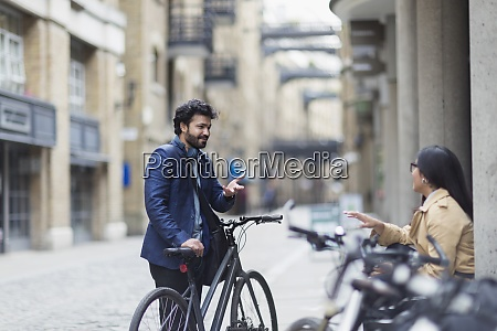 business people with bicycles talking on