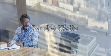 thoughtful businessman working in conference room