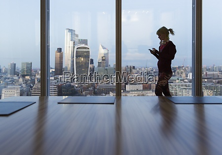 businesswoman using smart phone at highrise