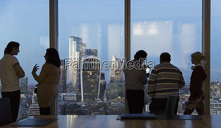 business people talking at highrise office