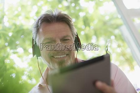 smiling senior man listening to music