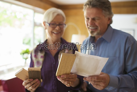 senior couple looking at wood and