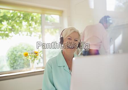 happy senior woman with headphones video