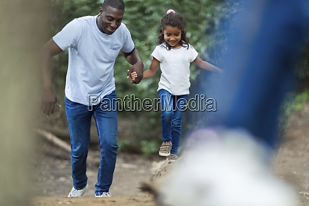 happy father and daughter running in