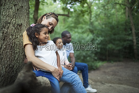 happy family resting on hike in