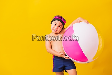 child boy smiling in swimsuit hold