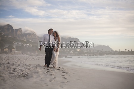 happy newly married couple walking at