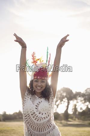 happy woman wearing native american headdress