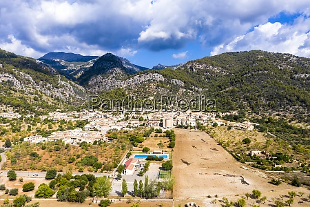 aerial view of village near mountains