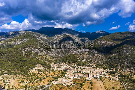 aerial view of village near mountain
