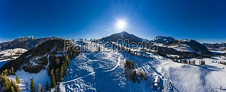 helicopter panorama of sun shining over