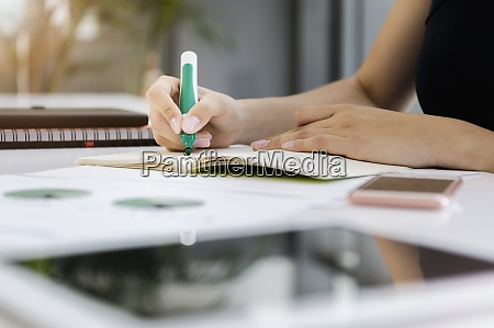 close up of businesswoman writing on