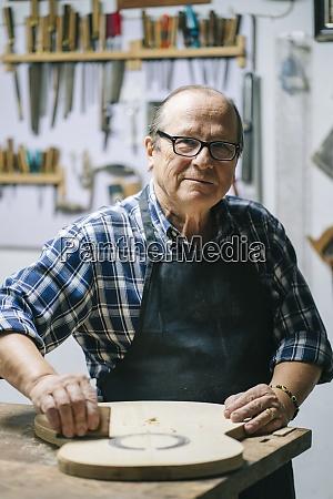 smiling man working at workshop