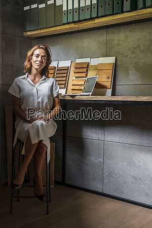 businesswoman with wood tiles sitting by