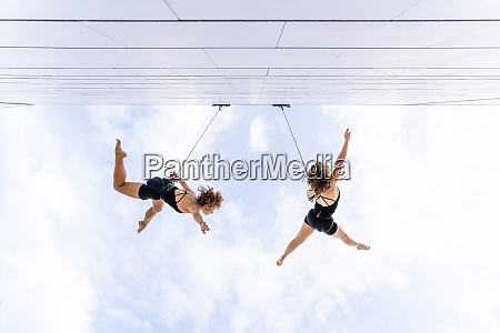 aerial dancers with hand raised dancing