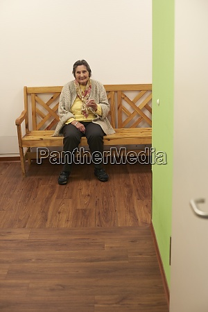age demented senior woman sitting on