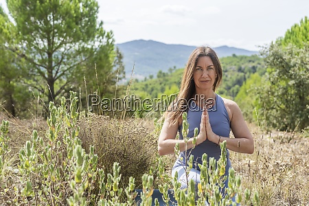 beautiful woman practicing yoga while crouching