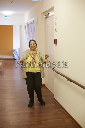 age demented senior woman dancing on
