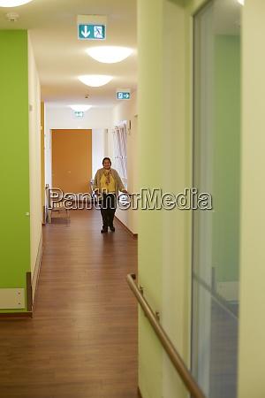 age demented senior woman on corridor