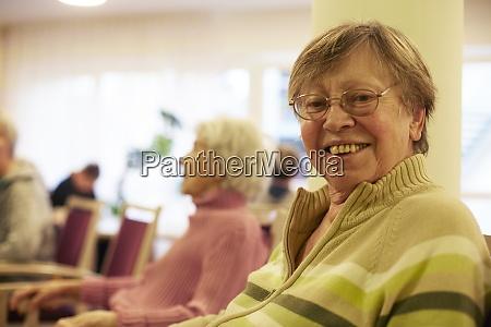 portrait of age demented senior woman