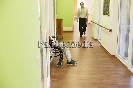 age demented senior man walking on