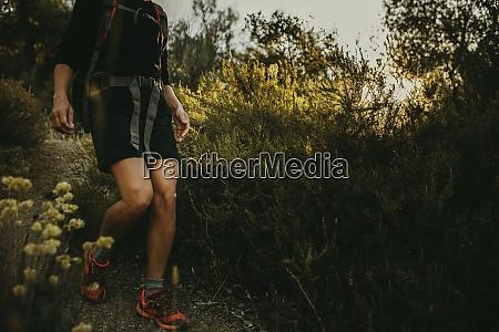 woman walking on footpath at sierra