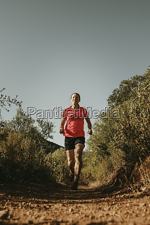 woman running on footpath at sierra