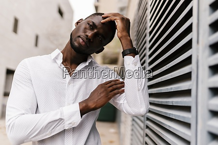 thoughtful businessman looking away while leaning