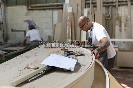 furniture design paper on workbench with