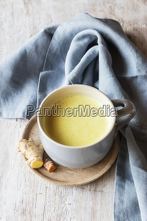 turmeric milk with root kept by