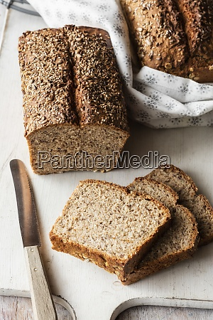 loaf and slices of brown bread