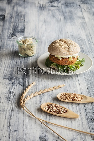 vegetarian burger and two wooden spoons