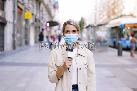 female journalist wearing mask with microphone