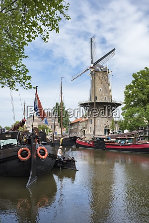 netherlands gouda harbor with traditional sailing