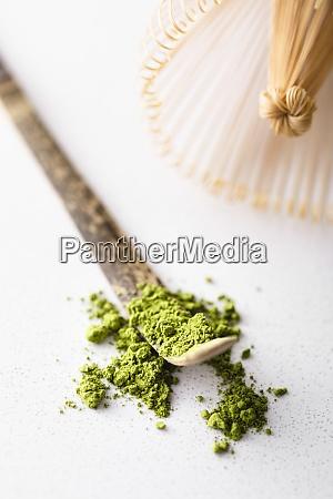 matcha tea powder on traditional wooden