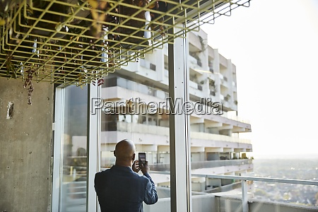mature man looking out of window