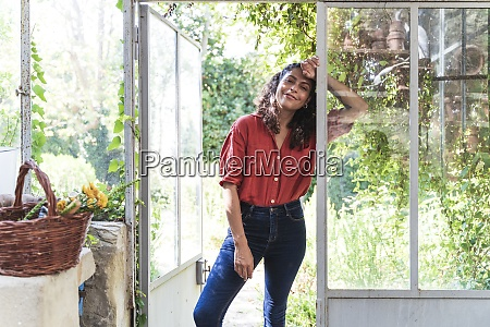 woman leaning on glass door in