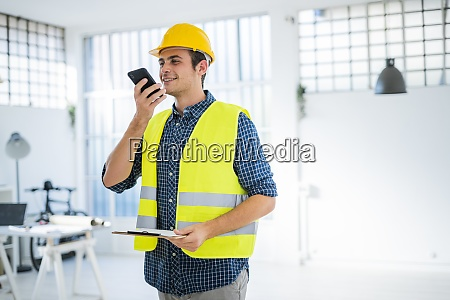 smiling young man talking on mobile