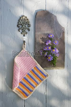 crocheted potholder hanging at hook