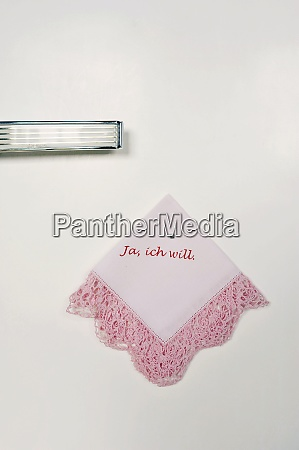 printed old handkerchief hanging on wall