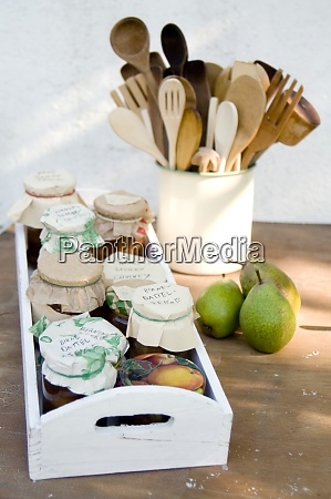 wooden tray with preserving jars of