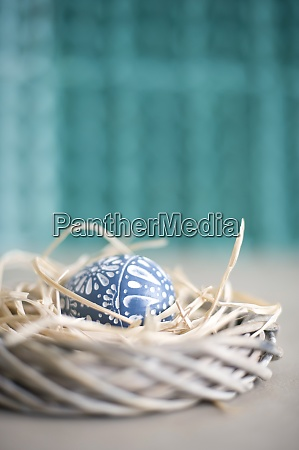 easter decoration with wreath straw and