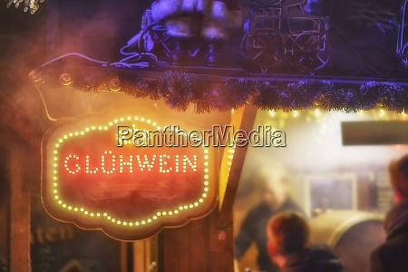 illuminated sign at tavern saying mulled