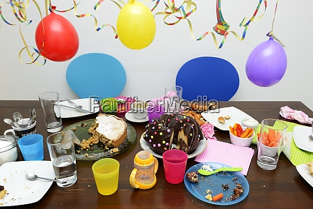 table with leftovers of childrens birthday